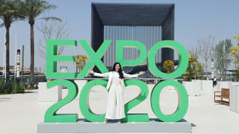 Ann Molin, Founder and Secretary General of Hack for Earth Foundation in front of the Expo2020 sign in Dubai