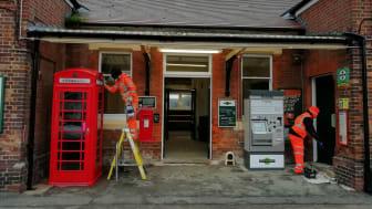Workmen refurbish the street-level ticket hall