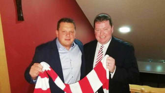 Kenny Bruce MBE (left), Larne FC owner, with Club Chairman Gareth Clements