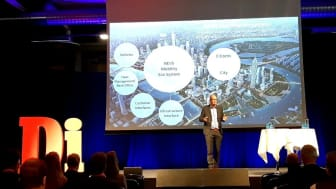 NEVS CEO Stefan Tilk on stage presenting NEVS vision in future mobility.