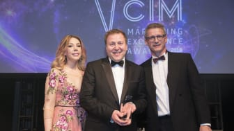 Stephen King (centre) collects his award from comedian and host Katherine Ryan and from sponsor Paul Carr, managing director of Stopgap
