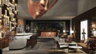 """Unter dem Blick der riesigen Maske geht es von der Lobby direkt ins Herzstück des Hotels, die """"K"""" Bar  © Timothé Coutellier"""