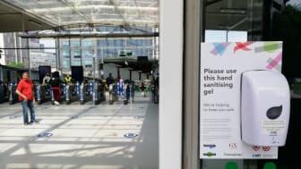 Social distancing at East Croydon station - hand sanitiser
