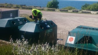 Mounting of transponders on glass recycling containers in Sweden.