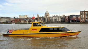 DHL Express riverboat on river with St Pauls.jpg