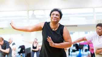 A woman takes part in a group dance class