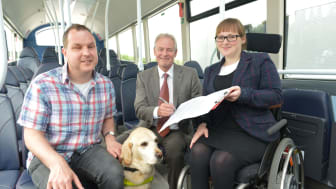Bus user Angus Huntley and his guide dog Kira with Kevin Carr from Go North East and RNIB's Fran Di Giorgio