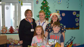 Jeanette Deboo and her daughter Kathryn presented the donations to Janine Standing, play specialist at East Surrey Hospital, and two young patients on the ward.