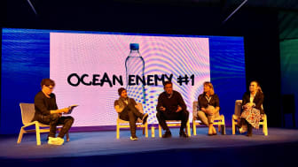 Bluewater Founder and CEO Bengt Rittri (center) explains how Bluewater has put ending the need for single use plastic bottles at the core of its business mission