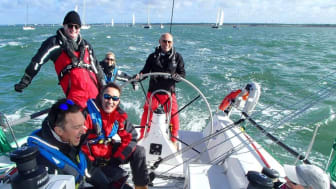 Sailor Simon Grier-Jones, pictured at the helm on another occasion, fell overboard while sailing in the Solent and was successfully recovered following the activation of his Ocean Signal rescueME MOB1. Credit: Snow Leopard Racing