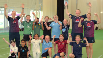 Members of the England cricket team enjoy a day's training with 11 lucky competition winners as part of Heather's Pride
