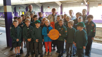 Members of 1st Bournville Scout Group with their Cross City Heroes plaque at Bournville station