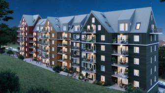 Bostadsrättsföreningen Träkronan i trä lever upp till namnet med nya fantastiska lägenheter som går i samklang med den intilliggande skogen. Bild: FO Arkitektkontor AB