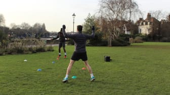 An activity session takes place in a park close to the Thames