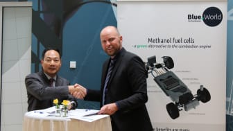 Wang Yanqing, Chairman at Wuxi Lead Intelligent Equipment Co., Ltd., and CEO at Blue World Technologies, Anders Korsgaard, signs partnership agreement