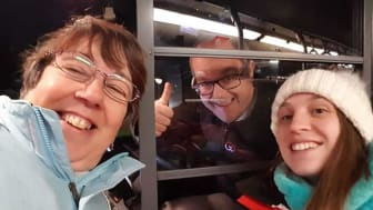 Two happy Lumiere-goers with their friendly Go North East driver