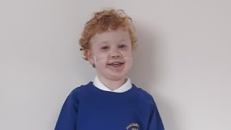 Miracle: Kaleb Lewis, aged four, marks a significant milestone of starting school after the amazing efforts of the team at the Birmingham Women's and Children's NHS Foundation Trust where he was monitored as part of the RAPID Project
