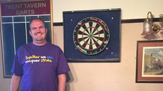 Stroke survivor takes on 12 hour darts marathon for charity