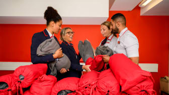 Virgin Trains employees with the street bags and blankets upcycled from old uniforms