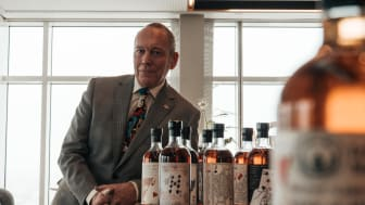 """Swedish whisky enthusiast Pye Palm at Upper House with parts of his """"full deck"""" of unopened Ichiro's Malt Card collection from the Hanyu distillery in Japan."""