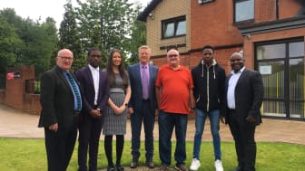 ng homes CEO Robert Tamburrini, Gervais Hameni, HR Officer Olivia Friary, Depute Director (Corporate Services) Tony Sweeney, Chair John Thorburn, Yvan Mbadjou and African Challenge Scotland Founder Ronier Deumeni