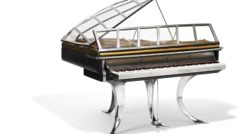"Poul Henningsen: ""PH Grand Piano"". Black stained wood, chrome steel and edge covered with black leather. Sold for: DKK 2,450,000 (EUR 430,000 including buyer's premium)."
