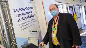 Cllr Paul Clark, Hitchin ward member and executive member for planning and transport at North Herts District Council, uses an e-ticket at Hitchin station