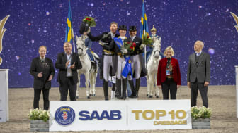 Saab Top 10 podium. Left to right: Swedish chef d'equipe Bo Jenå, Håkan Buskhe, CEO SAAB, second placed Patrik Kittel, winner Isabell Werth, third placed Dorothee Schneider, judge by C Annette Fransen Iacobaeus, Ulf Rosengren, President SIHS.