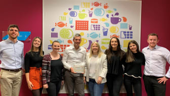 Louise Stigant UK MD & team proudly pose with their award