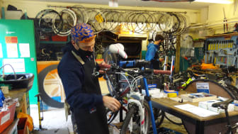 Frame for the future: Southwark-based cycling instructor Stewart Vanns inspects bikes donated by Southern Railway
