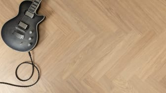 The classic herringbone patterned oak strips have been scaled up to fit larger surfaces.