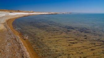 Panorama view to Aral sea from the rim of Plateau Ustyurt near Duana cape in Karakalpakstan, Uzbekistan   Photo: Adobe Stock