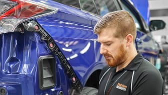 Thatcham Research MET engineer replaces an ADAS box