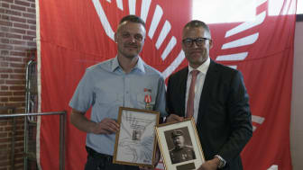 Emergency Medical Technician Anders Bruun Rasmussen is awarded with the  Sophus Falck Medal of Honour by Falck CEO Jakob Riis.