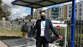 Solar-powered cycle security: Station Manager James Miller invites cyclists to New Southgate's environmentally friendly bike shelter
