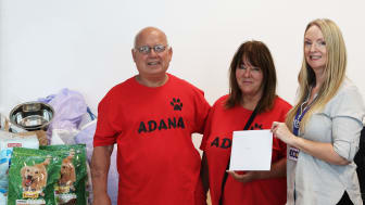 Hugely appreciated: ADANA's Reg Winkworth and Susan Brown accept cash and supplies donations from ECC's Sharon Johnson