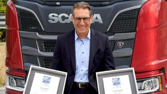 Christian Hottgenroth, Direktor Verkauf Lkw, Scania Deutschland Österreich freut sich über die Auszeichnungen des ETM Verlags.