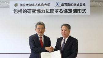 Signing ceremony with President Kenji Kawano of TSUNEISHI SHIPBUILDING (right) and President Mitsuo Ochi of Hiroshima University (left)