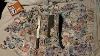 [Recovered cash and weapons]