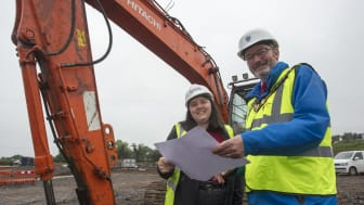 Mayor of Mid and East Antrim, Cllr William McCaughey, looks over the plans at Sullatober HRC along with Site Manager, Jessica Stronge from CIVCO.
