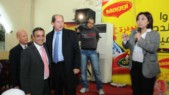 Assma Tellawi on the right together with the Chairman of Nestlé, Mr. Paul Bulcke (blue shirt/tie).