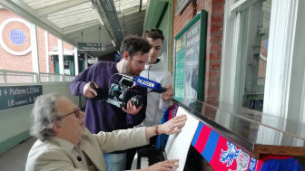 Champions League anthem composer Tony Britten was interviewed by Crystal Palace Football Club's Palace TV at Thornton Heath railway station