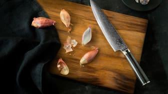 Knives_EGO-VG10_Chef Knife EVG20CK_w_garlic_landscape