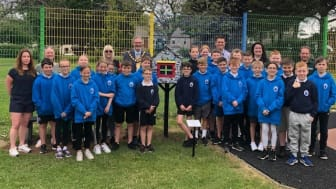 Pictured is the pupils from Olderfleet Primary School at the Little Free Library, at Curran Park Larne.
