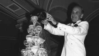 29th June 1978: A waiter pours champagne into a tower of glasses to celebrate the opening of a new Casino at the Ritz Hotel, London. (Photo by Evening Standard/Getty Images)