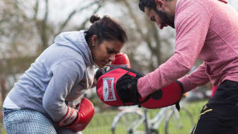 A woman takes part in a Box-Fit session in a local park