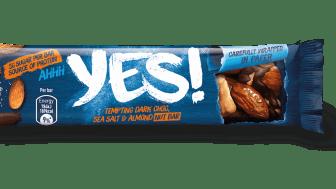 Säg YES! till en bar gjord på hållbart producerade nötter och frukt med en förpackning av papper.