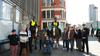 Brighton station manager Anthony Dowsett (third from left) gave disabled people a train ride to London Blackfriars station to help foster independent travel. They were welcomed there by the mounted branch of the City of London Police
