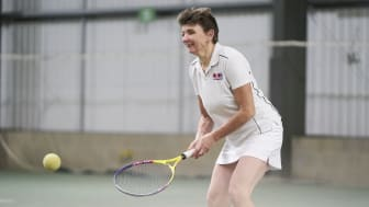 A visually impaired tennis player enjoys a game