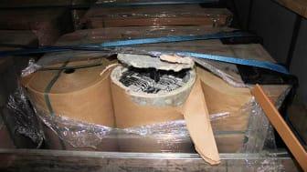 Cigarettes hidden inside asbestos and concrete tubes (SE 19.17)